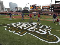 The Rangers arrive at Busch Stadium for a workout the day before the start of the World Series.