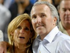 Los Angeles Dodgers owner and chairman Frank McCourt and his wife, Jamie McCourt, is seen after a 2008 Dodgers' game. Jamie will reportedly receive $130 million in the couple's divorce settlement.