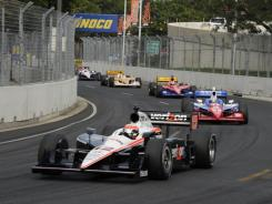 Will Power leads the Izod IndyCar Series field through Turn 9 of the inaugural Baltimore Grand Prix on Sept. 4. The event attracted an estimated crowd of 75,000.