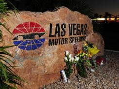 A makeshift memorial for Dan Wheldon sits outside Las Vegas Motor Speedway on Monday. IndyCar's new 2012 chassis will be named  after Wheldon, according to reports.