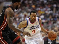 Guard Andre Iguodala, right, driving on the Heat's LeBron James during an April 24 playoff game, is due $13.5 million from Philadelphia this season, but the 76ers had been exploring trade options this summer.