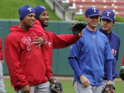 From left, the Rangers' Adrian Beltre, Elvis Andrus, Michael Young and Ian Kinsler gather during a workout Tuesday at Busch Stadium, where they'll play Game 1 of the World Series.
