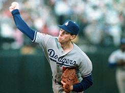 Dodgers ace Orel Hershiser, delivering overhand against the A's in the 1988 World Series, says he served up a sidearm curveball to cross up Jose Canseco.