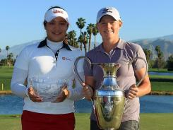 Ariya Jutanugarn of Thailand, left, shown with Stacy Lewis at the Kraft Nabisco Championship, earns Rolex Player of the Year honors from the AJGA. Jutanugarn was the low amateur at the Kraft, and Lewis won the title.