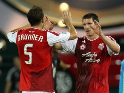 The Timbers' Kenny Cooper, right, is congratulated by Eric Brunner after his 24th-minute goal at RFK Stadium. The 1-1 draw with D.C. United kept Portland's playoff hopes alive.