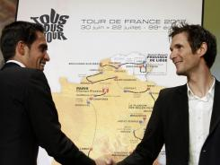 Spain's Alberto Contador (left) shakes hands with Luxembourg's Frank Schleck during the presentation of the 2012 Tour de France cycling race on Tuesday in Paris.