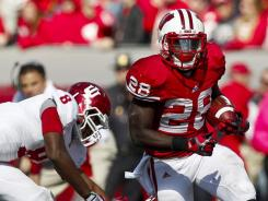 Montee Ball (28) and Wisconsin steamrolled Drew Hardin (8) and Indiana last week.