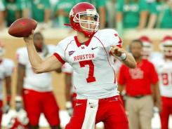 Houston  quarterback Case Keenum has led the Cougars to a 6-0 record through the first half of the season.
