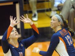 Illinois setter Annie Luhrsen, left, and Erin Johnson  have helped the team reach No. 1 in the country for the first time in school history.