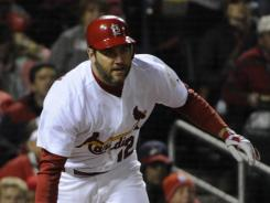 Lance Berkman heads to first after one of his two Game 1 hits, this one driving in two runs in the fourth inning of a 3-2 win. The 35-year-old revived his career playing right field in St. Louis. He hit .301 with 31 homers and 94 RBI.