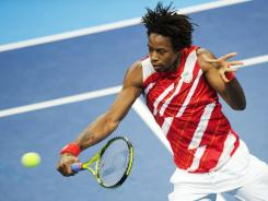 Gael Monfils of France lines up a backhand during his victory Thursday in Stockholm.