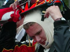In this photo from the 2005 Indianapolis 500, Dan Wheldon straps on his helmet. Wheldon was killed Sunday at Las Vegas Motor Speedway.
