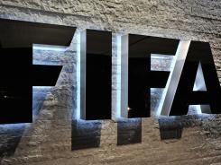 The FIFA logo is seen outside the company's headquarters during its executive committee meeting on Thursday in Zurich. The Sports Business Journal reports that Fox has won rights for the next two World Cups.