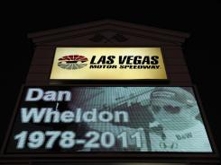 A memorial to Dan Wheldon is displayed on a Las Vegas Motor Speedway sign. Wheldon was killed during the Las Vegas Indy 300.