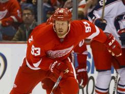Red Wings left wing Johan Franzen, right, skates with the puck as Blue Jackets center Antoine Vermette gives chase in the third period.