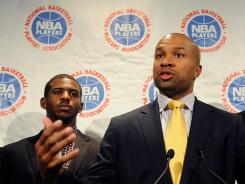 """NBA players union president and Los Angeles Lakers guard Derek Fisher, right, tells the news media the owners """"lied"""" in telling their side of the negotiations collapse, as New Orleans Hornets guard Chris Paul observes."""
