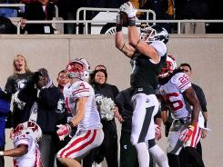 Michigan State wide receiver Keith Nichol makes the game-winning catch on the final play against Michigan State.