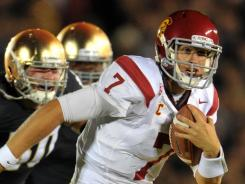 USC quarterback Matt Barkley runs for a first down against the Notre Dame on Saturday. Barkley scored three times in the Trojans' 31-17 victory.