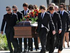 Dan Wheldon's brothers and fellow IndyCar drivers were among the pallbearers at his funeral Saturday.