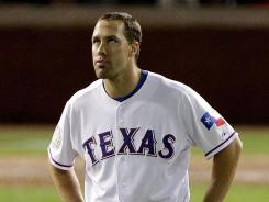 The Texas Rangers' David Murphy stews after after making the last out of the seventh inning during Game 3 on Saturday.