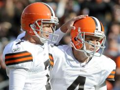 Cleveland Browns punter Brad Maynard (7) congratulates kicker Phil Dawson after he successfully kicked a 48-yard game-winning field goal against the Seahawks.