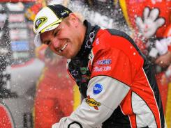 Clint Bowyer celebrates his first race victory of 2011 and possibly his last with Richard Childress Racing; he's leaving for Michael Waltrip Racing in 2012.
