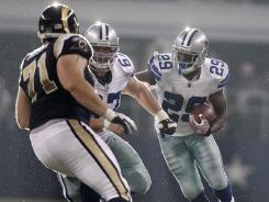 Dallas Cowboys running back DeMarco Murray (29) gets a block from teammate Phil Costa (67) against St. Louis Rams defensive tackle Gary Gibson during their game in Arlington, Texas.
