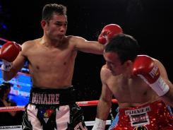 Nonito Donaire, left, connects with a left to Omar Narvaez in their WBC, WBO World Bantamweight Titles bout at Madison Square Garden on Saturday.