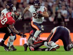 Chicago Bears running back Matt Forte (22) carries the ball against the Tampa Bay Buccaneers during their game at Wembley Stadium.