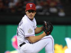 Derek Holland threw 8 1/3 strong innings as the Rangers won Game 4 4-0.