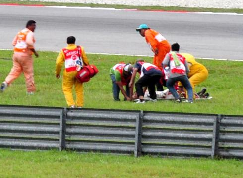 MotoGP rider Marco Simoncelli, is lifted onto a stretcher after a