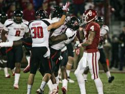 Texas Tech celebrate after breaking up a pass intended for Oklahoma's Kenny Stills (4) in the second half.