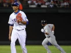 Rangers' Alexi Ogando had a 1.17 ERA in the first two rounds of the playoffs, but has a 27.00 ERA in the World Series.