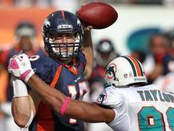 Broncos quarterback Tim Tebow, getting his first start of the season, led Denver to an overtime comeback win in Miami.
