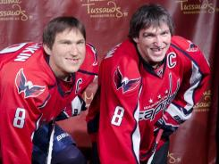 Alex Ovechkin poses with his wax figure at Madame Tussauds on Monday. He's the one on the right.