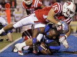 Middle Tennessee running back William Pratcher loses his helmet as he is tackled in the end zone for a safety by Western Kentucky defensive back Ryan Beard (15) in the third quarter of their game in early October.