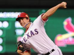 """I wanted to show I belong here,'' says Rangers starter Derek Holland, pitching in the first inning Sunday. ""I wanted to make a name for myself and at the same time to get momentum back on our side."