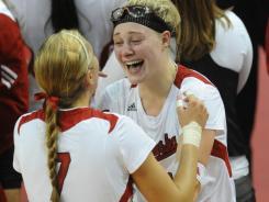Nebraska's Hannah Werth, right, celebrates with Gina Mancuso after handing Illinois its first loss of the season  Saturday.