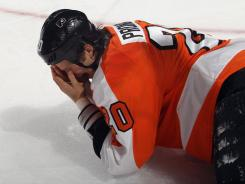 Chris Pronger left the game with about eight minutes left in the first period after being struck in the face by an opponent's stick.