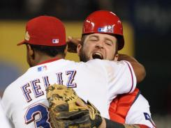 Rangers closer Neftali Feliz, left, hugs catcher Mike Napoli