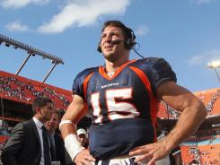Broncos quarterback Tim Tebow does an interview after the Broncos defeated the Dolphins in overtime 18-15.