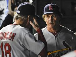 Cardinals manager Tony La Russa, right, talks with pitching coach Dave Duncan in the dugout during the eighth inning of Game 5.