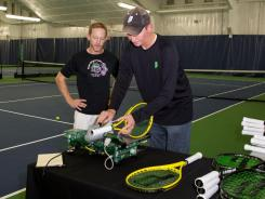 Prince racket guru Ken Merritt, right, works to refine a racket for the author.