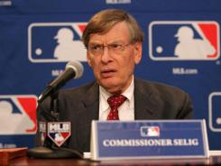 MLB Commissioner Bud Selig, seen here Sunday at a news conference, wants a system of fixed signing bonuses that tie the amount to the round when a prospect is drafted.