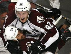 Colorado's Gabriel Landeskog leaps into the arms of Daniel Winnik after scoring the tying goal late in the third period against Chicago last weekend.