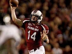 South Carolina quarterback Connor Shaw, above, and Georgia Southern quarterback Jaybo Shaw are the sons of Flowery Branch, Ga., football coach Lee Shaw. Their three teams are a combined 21-1 this season.