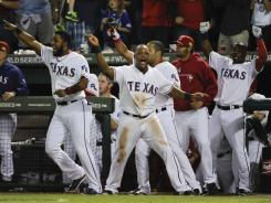 Rangers players celebrate Monday night after Mike Napoli's two-run double in the eighth inning drove in the decisive runs in Texas' 4-2 victory against the Cardinals in Game 5.