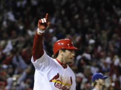 Cardinals third baseman David Freese rounds the bases after hitting the game-winning home run in the bottom of the 11th inning.