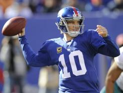 Giants quarterback Eli Manning has thrown for at least 223 yards in each game this season and has accounted for 14 touchdowns. Sunday against the Dolphins, above, he threw for 349 yards and two touchdowns.