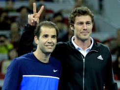 Marat Safin, right, has a little fun with Pete Sampras during  an exhibition match to inaugurate the opening of the new stadium during the China Open in September.
